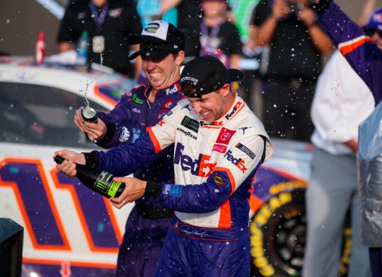 Denny Hamlin celebrates with his teammates after winning the Bluegreen Vacations 500 at ISM Raceway to punch his ticket to the Championship 4.