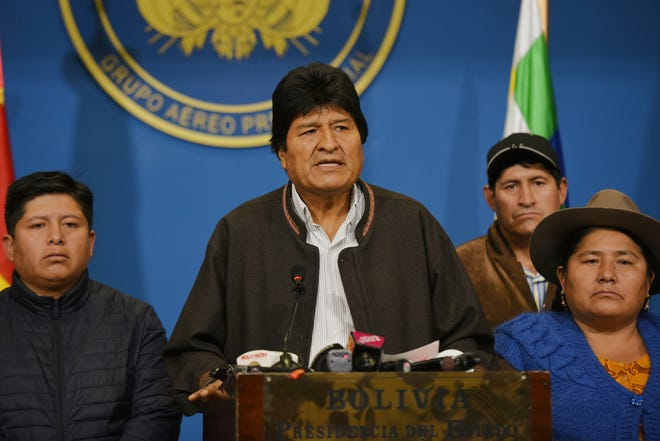 In this photo provided by the Agencia Boliviana de Informacion, Bolivian President Evo Morales speaks from the the presidential hangar in El Alto, Bolivia, Sunday, Nov. 10, 2019.