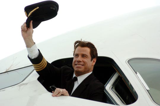 John Travolta shares a rare glimpse of son Ben, 8, flying a plane: He's 'taking my place'