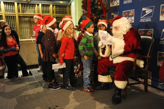 Second-graders from PS 33 deliver their letters to Santa in person at New York's Farley Post Office on Dec. 4, 2012, as part of Operation Santa.