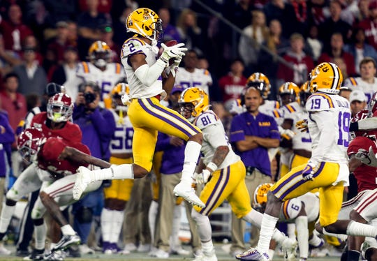 LSU wide receiver Justin Jefferson pulls in the onside kick to seal the team's 46-41 defeat of Alabama at Bryant-Denny Stadium.