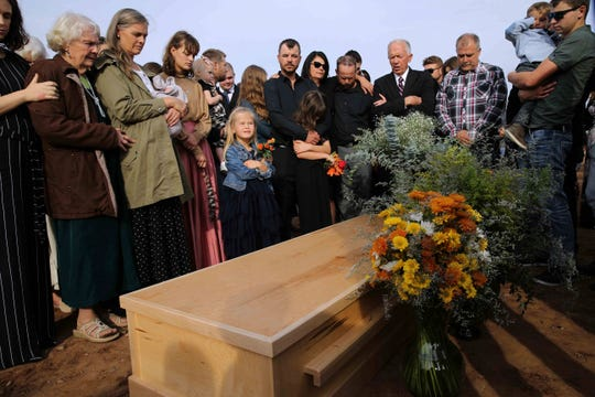 Family and friends attend the burial service of Christina Langford Johnson the last victim of a cartel ambush that killed nine American women and children earlier this week, in Colonia Le Baron, Mexico, Saturday.