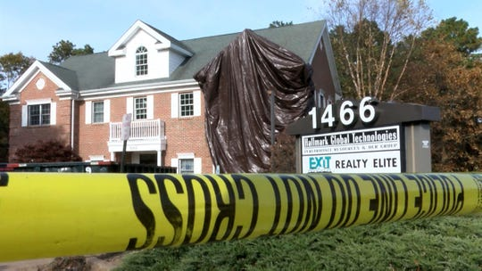 A tarp covers the gash in the second floor of 1466 Hooper Avenue in Toms River Monday, November 11, 2019, where a car crashed the previous day - killing two people.