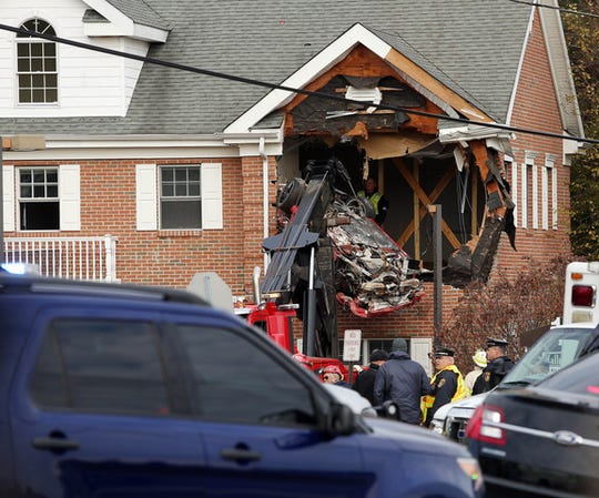 A red Porsche crashed into the second story of 1466 Hooper Ave. in Toms River Sunday, Nov. 10, killing two occupants