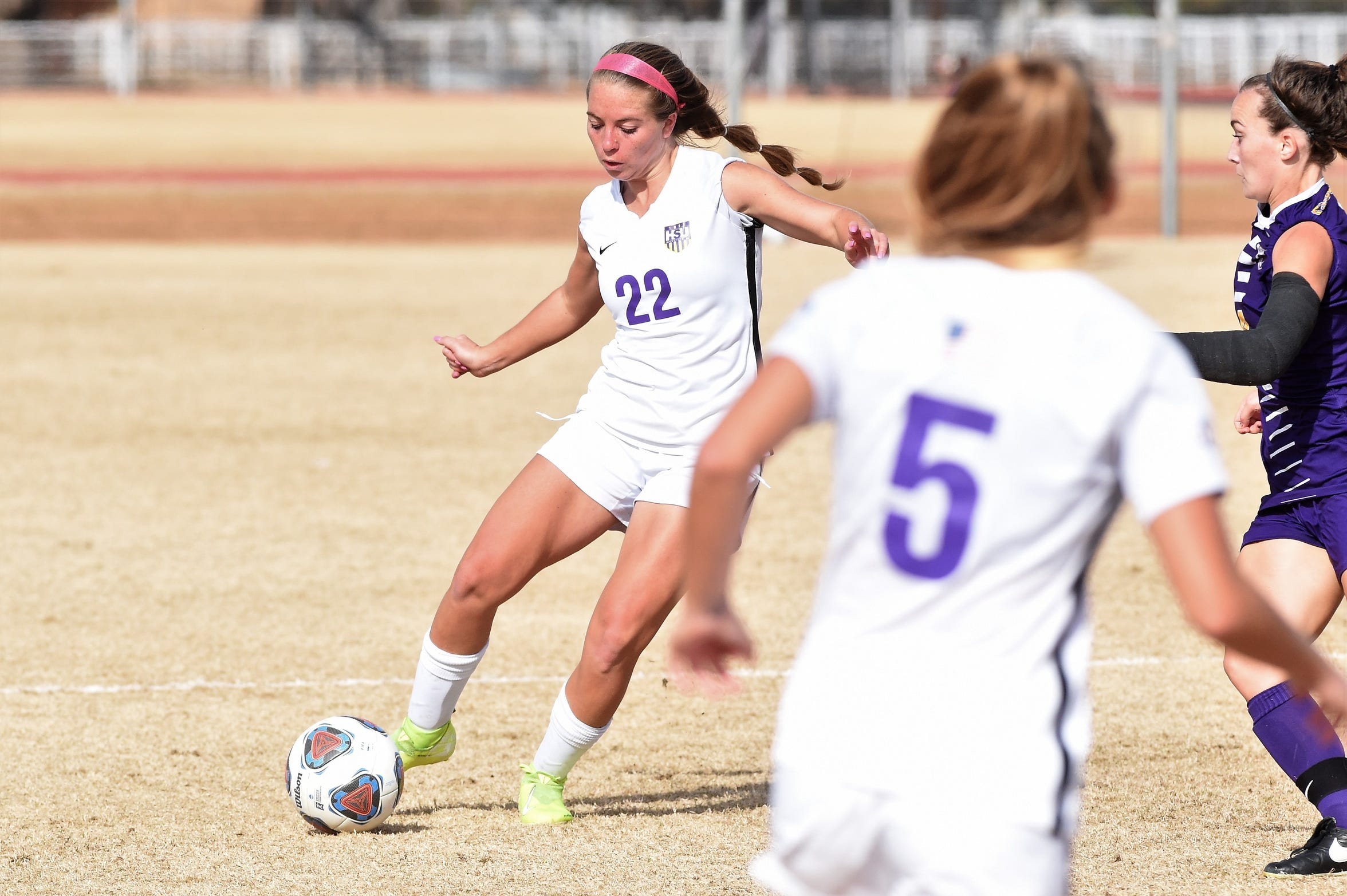Hardin-Simmons' Kendell Groom (22) passes the ball against Mary Hardin-Baylor in the ASC tournament championship at the HSU Soccer Complex on Sunday, Nov. 10, 2019. The Cowgirls won 2-0 for their 17th-straight tournament title.