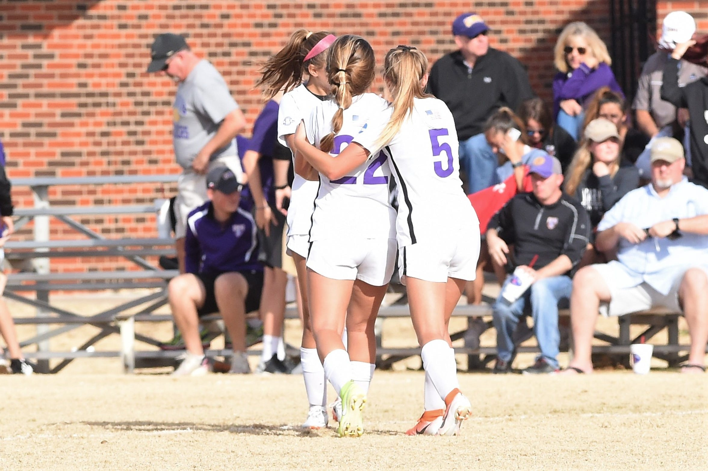 Hardin-Simmons seniors Kendell Groom (22) and Michaela Sabrsula (5) hug after beating Mary Hardin-Baylor in the ASC tournament championship at the HSU Soccer Complex on Sunday, Nov. 10, 2019. The Cowgirls won 2-0 for their 17th-straight tournament title.