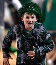 Hudson Smith, 12, runs off the field at halftime Friday. Hudson was rooting for the Hamlin Pied Pipers, who won their District 7-2A Division II championship game against Albany.