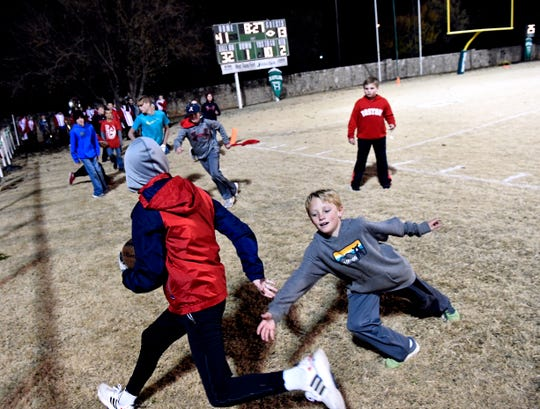 Young fans play a little football of their own on the Albany side of Hamlin's Piper Stadium during halftime at Friday's District 7-2A Division II championship game.