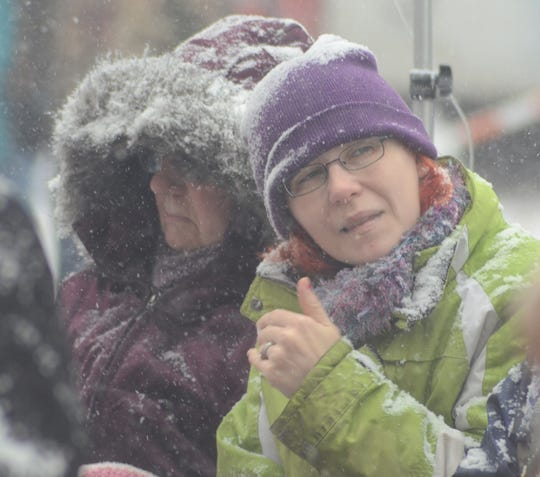 Alison Burghdoff, right, of Battle Creek, and her grandmother, Rose Burghdoff, of Plainwell, were bundled against the snow.