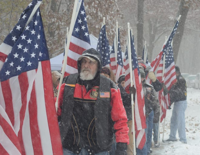 Members of American Legion #298 of Battle Creek line up with flags.