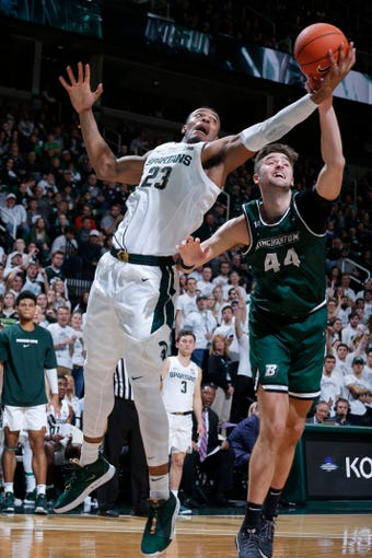 Michigan State's Xavier Tillman, left, and Binghamton's Yarden Willis (44) reach for a rebound during the second half of an NCAA college basketball game, Sunday, Nov. 10, 2019, in East Lansing, Mich. Michigan State won 100-47. (AP Photo/Al Goldis)