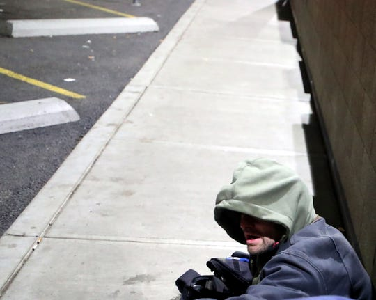 David Lund prepares to spend the night outside the Salvation Army building on Thursday.