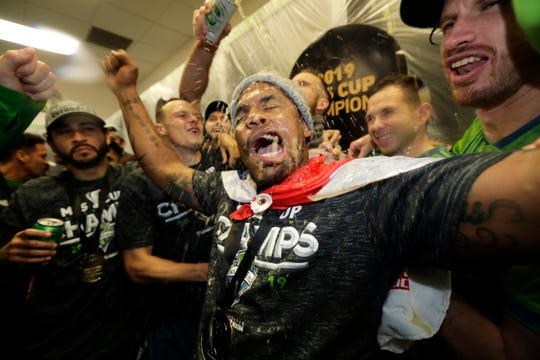 Seattle Sounders defender Roman Torres celebrates in their locker room, Sunday, Nov. 10, 2019, after defeating Toronto FC in the MLS Cup championship soccer match in Seattle. The Sounders won 3-1. (AP Photo/Ted S. Warren)