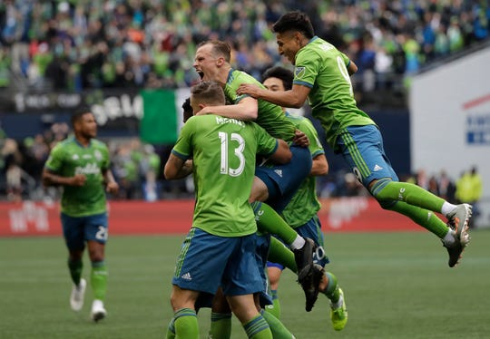 Seattle Sounders celebrate after Kelvin Leerdam scored against the Toronto FC, Sunday, Nov. 10, 2019, during the second half of the MLS Cup championship soccer match in Seattle. (AP Photo/Ted S. Warren)