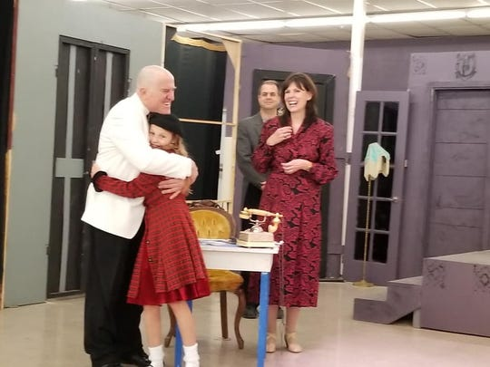 "Annie (Zoe Cook) finds her ""Daddy"" Warbucks (Jeffrey Bassett, left), to the delight of Drake (Marsh Marshall) and Grace Farrell (Diane Daniels)."