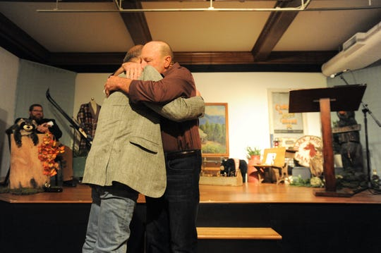 Swannanoa Valley native and retired Owen football head coach Kenny Ford embraces Wendell Begley in the Gale Jackson Theatre at the Black Mountain Center for the Arts, Nov. 8. Ford was one of several speakers who shared stories about Begley, who announced he was stepping down as the chair of the Swannanoa Valley Museum & History Center Board of Directors after 21 years.