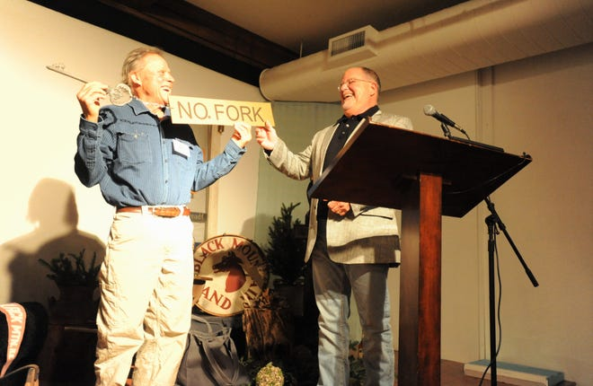 """Van Burnette, left, a seventh-generation resident of the North Fork community in Black Mountain, names Wendell Begley an """"honorary member of the Burnette clan,"""" during a ceremony recognizing Begley for 21 years of serving as the chair of the Swannanoa Valley Museum & History Center Board of Directors."""
