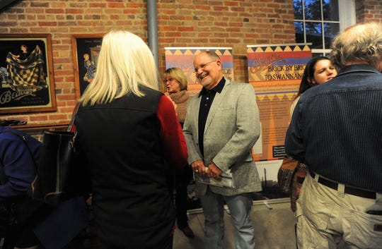 Wendell Begley, who was recognized by the Swannanoa Valley Museum & History Center, Nov. 8, after 21 years of serving as the board chair, greets guests during a reception in his honor.