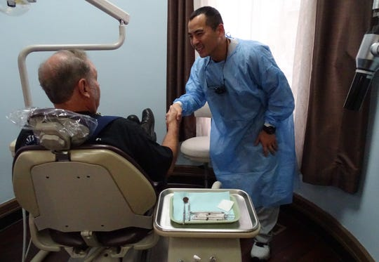 Dr. Hsuan-Li Lin shakes hands with Joe Kennedy, one of eight local veterans who received a free dental cleaning and checkup Monday at Bucyrus Dental in honor of Veterans Day.