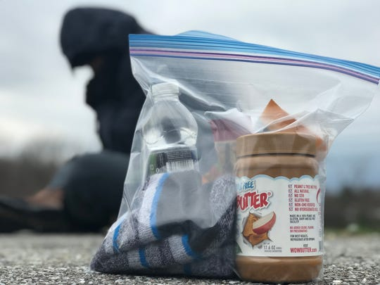 A photo illustration shows an example of a care package that could be shared with those experiencing homelessness.