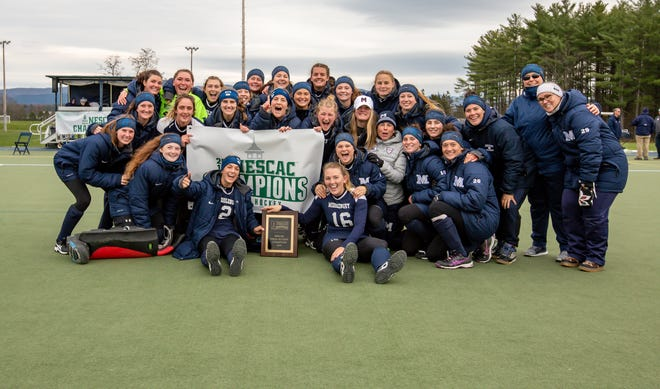 Middlebury College field hockey poses for a photo after winning the NESCAC championship on Sunday.