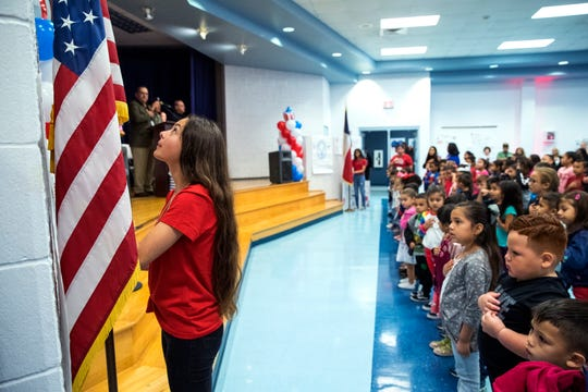 Children celebrate Veterans Day with a ceremony at the Dr. M.L. Garza-Gonzalez Charter School on Monday, November 11, 2019.