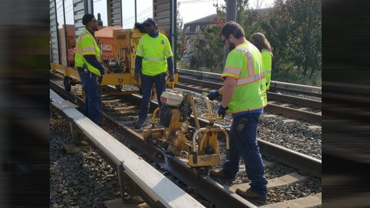 Crews work to repair a track defect on the PATCO Hi-Speedline between the Ferry Avenue and Broadway stations.