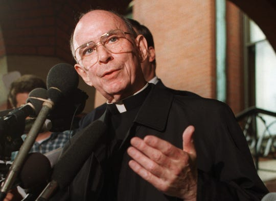 In this Sept. 23, 1996 file photo, Cardinal Joseph Bernardin speaks with reporters on the steps of his Chicago residence just before his departure for Rome to meet with Pope John Paul II.