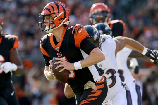 Cincinnati Bengals quarterback Ryan Finley (5) scrambles out of the pocket as he's pressured in the second quarter of a Week 10 NFL game against the Baltimore Ravens, Sunday, Nov. 10, 2019, at Paul Brown Stadium in Cincinnati.