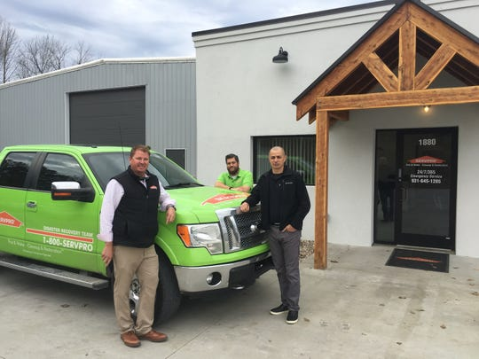 Standing in front of the newly renovated Servpro of Clarksville facility on Ashland City Road are franchise owner Brent Nicholson, left, marketing manager Ryan Millard and business development director Leo Millan.