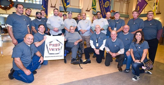 PSE&G employee volunteers paused for a team photo before the Menlo Park Veterans Memorial Home's fall festival.