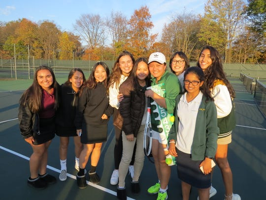 The W+H girls celebrate after Becky Qin clinched a share of the division title.