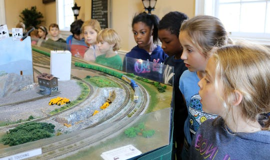 McKinley third graders enjoy a small scale model railroad with representations of major Westfield landmarks, past and present, during a walking tour of Westfield on Wednesday, Oct. 23.