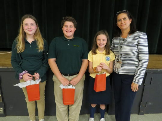 Middle School Head Dr. Corinna Crafton joins winners Vanessa Fang of Edison, Caleb Rothrock-Steinfeld of South Plainfield and Charlotte Szczubelek of Warren.