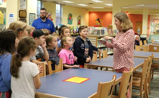 Westfield Memorial Library's Molly Adams gives McKinley third graders a tour on Wednesday, Oct. 23, that included a discussion of the Summer Reading Program, the difference between fiction and non-fiction, the Dewey Decimal System, and other topics.