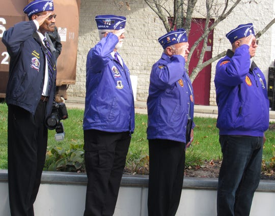 Veterans salute the flag during Veterans Day ceremonies in Somerville.