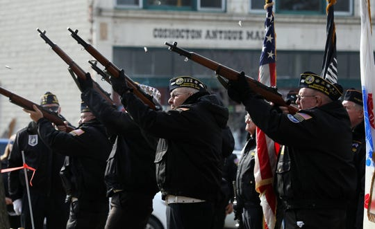 The Coshocton County Veterans Honor Guard fires a rifle salute during the annual Veterans Day ceremonies on the Court Square in Coshocton on Monday.