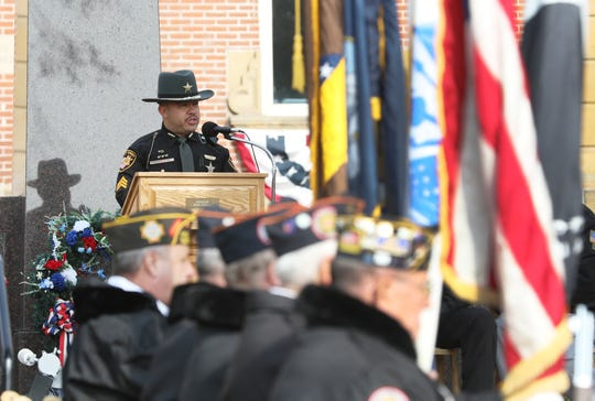 Phil Valdez, former Marine and current deputy with the Tuscarawas County Sheriff's Office, speaks during the Veterans Day ceremony on the Coshocton Court Square on Monday.