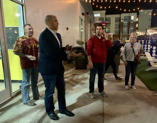U.S. Sen. Cory Booker prepares to throw a beanbag in a long-distance bags challenge at Smash Park.