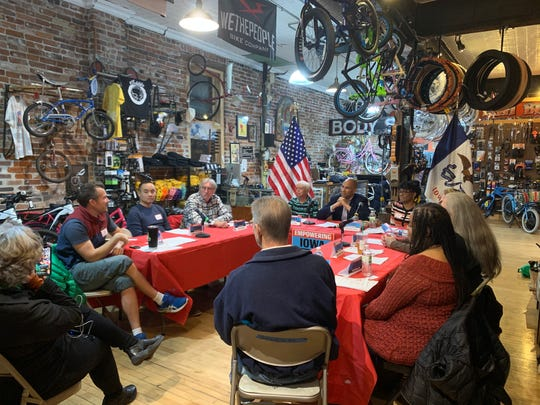 U.S. Sen. Cory Booker meets with business owners at Ichi Bike in Des Moines.