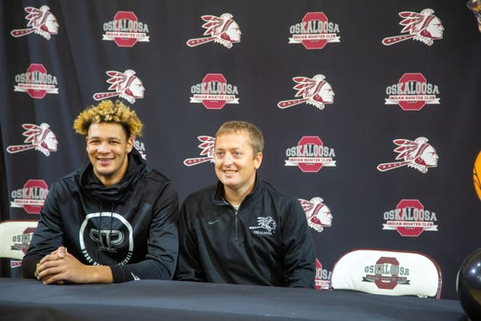 Oskaloosa basketball star Xavier Foster sits with Coach Ryan Parker after after announcing he's committing to Iowa State. Monday, Nov. 11, 2019.