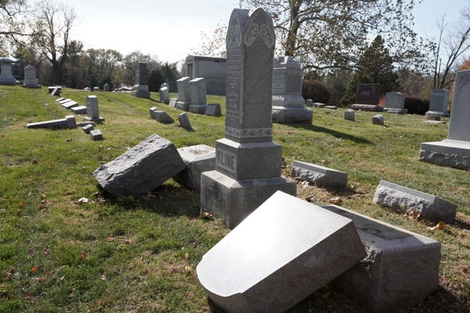 Toppled headstones are seen at the Jewish Temple Israel Cemetery in Omaha on Saturday. Police say about 75 headstones were toppled.