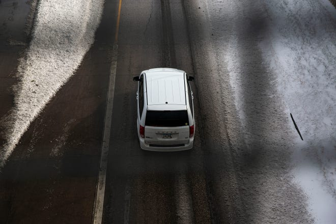 Drivers navigate wet and snowy roads on the ramps along Interstate 235 through downtown Des Moines on Monday, Nov. 11, 2019.