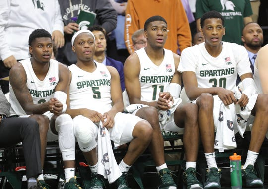 Michigan State's Rocket Watts (2), Cassius Winston (5), Aaron Henry (11) and Marcus Bingham Jr. (30) watch action against Binghamton, Sunday, Nov. 10, 2019 at the Breslin Center.