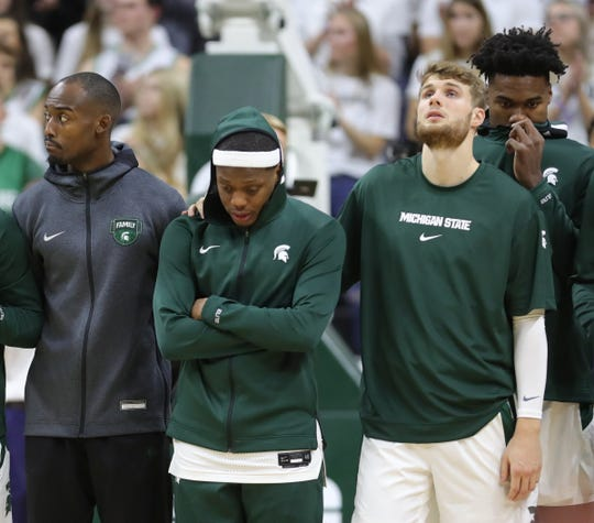 The Breslin Center observes a moment of silence for Zachary Winston, the brother of Michigan State Spartans guard Cassius Winston, center, before action against the Binghamton Bearcats, Sunday, Nov. 10, 2019 in East Lansing. At right is Kyle Ahrens.