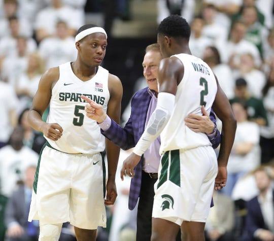 Tom Izzo talks with Michigan State guards Cassius Winston and Rocket Watts Jr. on Sunday, Nov. 10, 2019 at the Breslin Center.