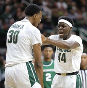 Michigan State's Marcus Bingham Jr. celebrates with Gabe Brown during the first half Sunday, Nov. 10, 2019 at the Breslin Center.