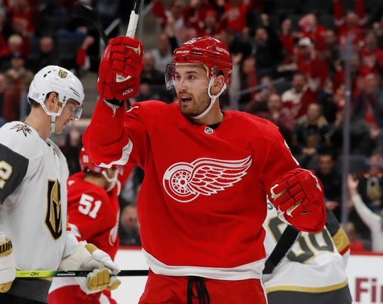 Red Wings left wing Brendan Perlini reacts after a goal by teammate center Andreas Athanasiou during the first period of an NHL hockey game against the Vegas Golden Knights, Sunday, Nov. 10, 2019, in Detroit.