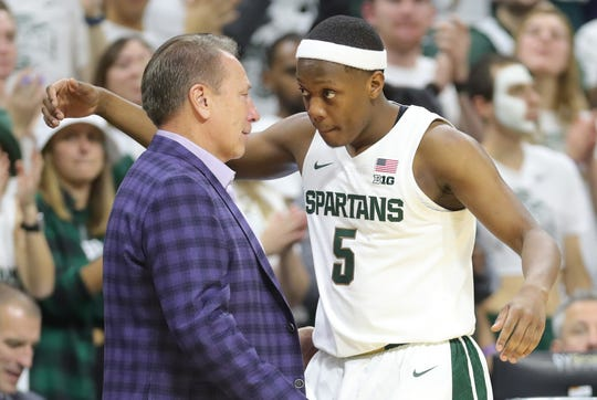 Tom Izzo embraces Michigan State Spartans guard Cassius Winston (5) as he left the game against the Binghamton Bearcats Sunday, November 10, 2019 at the Breslin Center in East Lansing, Mich.