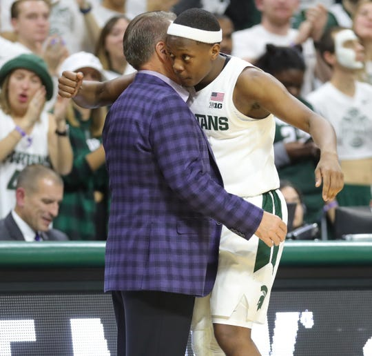 Michigan State's Cassius Winston embraces coach Tom Izzo as he exits in the second half of the 100-47 win over Binghamton, Sunday, Nov. 10, 2019 at the Breslin Center.